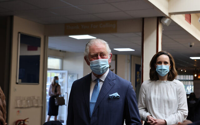 The Prince of Wales arrives for a visit to an NHS vaccine pop-up clinic at Jesus House church, London. Here he is pictured with Dr Charlotte Benjamin