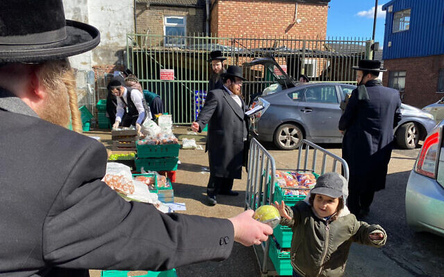 Jewish Community Council of North London photo of Jewish volunteers distributing hundreds of food packages to families ahead of Passover.