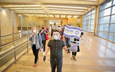 New olim arriving at Ben Gurion airport. Credit: Yonit-Schiller