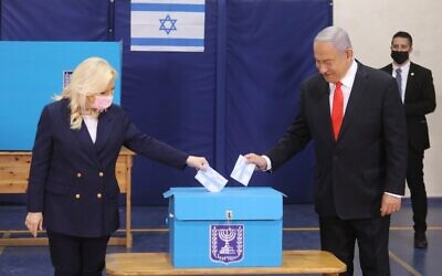 Israeli Prime Minister Benjamin Netanyahu casts his vote during the Israeli parliamentary elections in Jerusalem on March 23, 2021. Israelis began casting their votes on Tuesday morning in the fourth parliamentary election in two years, amidst lingering political deadlock and with polls suggesting a tight race. (Marc Israel Sellem/JINI/Handout via Xinhua)