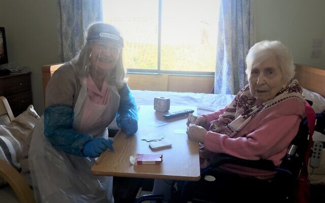 Ethel Fedor, 105, plays cards with her daughter Ros during a designated visit