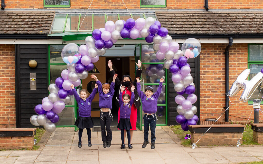 Pupils at Hertsmere Jewish Primary School in Radlett were welcomed back with a colourful balloon arch as students returned to the classroom for the first time in two months. Pictured are Year 1 students Ella Starkowitz, Zack Wolfisz, Sophie Hall and Ethan Goodman with headteacher Rita Alak-Levi. Credit: Claire Jonas Photography