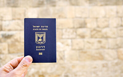 Holding the passport of the State of Israel
