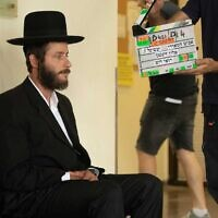Michael Aloni, who plays Akiva, during filming of Shtisel series 3. Credit: Vered Adir