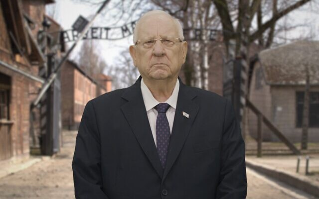 President Rivlin in front of the virtual Auschwitz gates