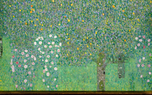 """The painting """"Rosebushes under the Trees"""" by Gustav Klimt hangs at the Musée d'Orsay museum in Paris, March 15, 2021. (Courtesy of the French Culture Ministry) via JTA"""