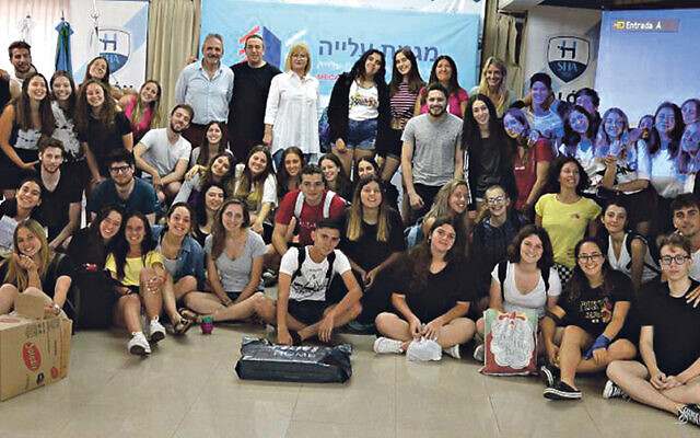WZO's Marina Rosenberg-Koritny, pictured rear centre, with a group of recent British olim who studied at its ulpanim
