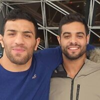 Israeli world champion judoka Sagi Muki, right, and Iranian champion Saeid Mollaei embrace at the Paris Grand Slam, February 10, 2020, in an Instagram photo posted online by Muki. (Instagram screen capture via Times of Israel)
