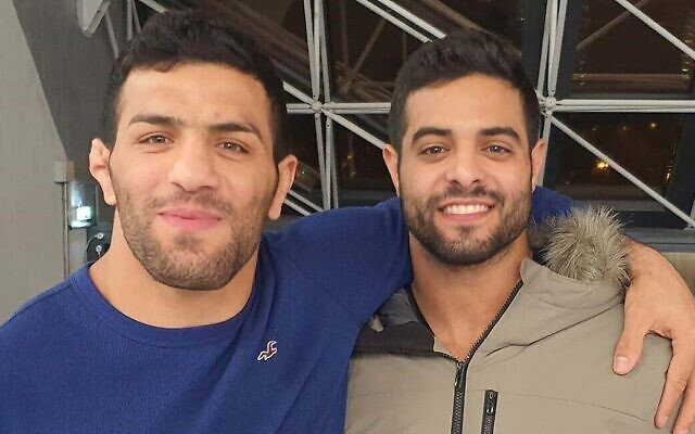 Israeli world champion judoka Sagi Muki, right, and Iranian champion Saeid Mollaei embrace at the Paris Grand Slam, February 10, 2020, in an Instagram photo posted online by Muki. (Instagram screen capture via Times of Israel)