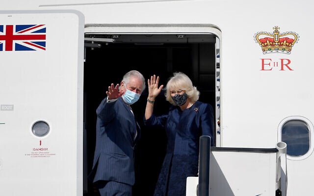 The Prince of Wales and the Duchess of Cornwall wave as they board a flight at Athens International Airport, Greece, after a two-day visit to Greece to celebrate the bicentenary of Greek independence.(PA Wire/PA Images/Victoria Jones)