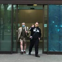 Ben Raymond (right), leaving Wesminster Magistrates' Court, London where he faced four charges, including membership of a proscribed organisation contrary to Section 11 of the Terrorism Act between December 17 2016 and September 27 2017, and three counts of possessing material likely to be useful for terrorism under Section 58 of the act. Raymond did not indicate pleas to any of the charges.