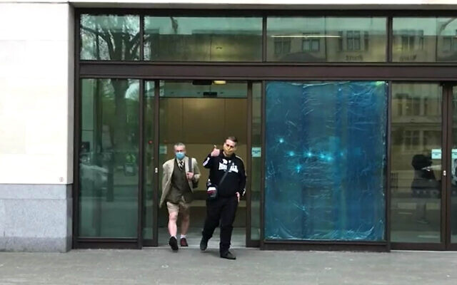 Screen grab of Ben Raymond (right), 31, leaving Wesminster Magistrates' Court, London where he faced four charges, including membership of a proscribed organisation contrary to Section 11 of the Terrorism Act between December 17 2016 and September 27 2017, and three counts of possessing material likely to be useful for terrorism under Section 58 of the act. Raymond did not indicate pleas to any of the charges.