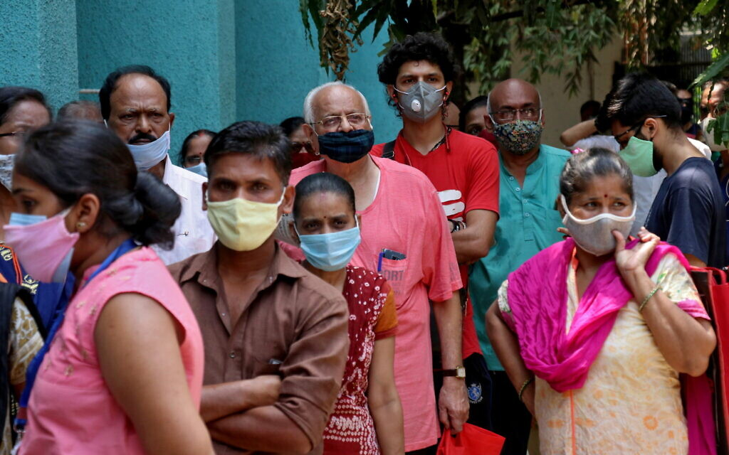 People wearing protective face masks wait to receive a vaccine at a centre in Mumbai (Photo: REUTERS/Niharika Kulkarni)