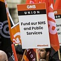 A GMB union banner at a TUC demonstration in 2018.