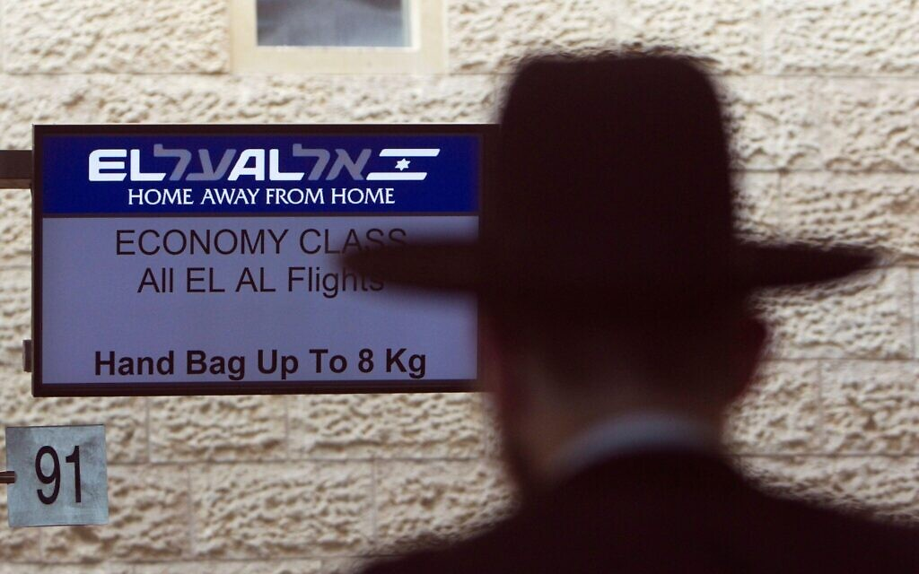 An El Al Israel Airlines logo is seen on an electronic board at a check-in counter at Ben Gurion International airport near Tel Aviv August 22, 2011.