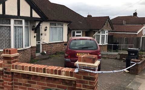 The police cordon outside a bungalow on Rushden Gardens in Ilford, east London, where an elderly lady was found dead in a bathtub on Friday. A 54-year-old man has been arrested on suspicion of murder. Picture date: Saturday April 10, 2021.