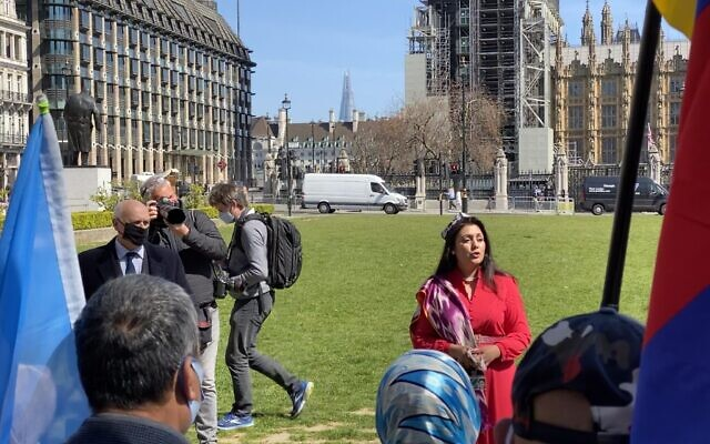 Nus Ghani speaking at a rally outside Parliament with Uyghur activists. (Credit: @finnlau_cd on Twitter)