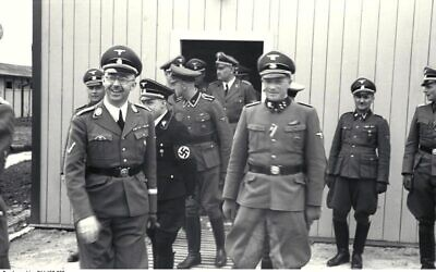 Franz Josef Huber (in doorway) with Heinrich Himmler, August Eigruber and other SS officers, at Mauthausen-Gusen concentration camp, June 1941. (Wikipedia/ Attribution: Bundesarchiv, Bild 192-352 / CC-BY-SA 3.0 - https://creativecommons.org/licenses/by-sa/3.0/de/legalcode)