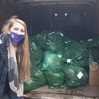 Hannah Gerson from US Chesed with bags of the essential packs ready to be sent out to asylum seeker families.