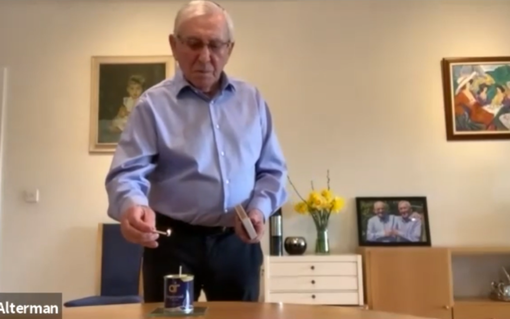 Ike Alterman lighting a candle for Yom HaShoah