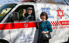 Norman and his wife Eve Rosenbaum with the latest MDA ambulance (Yakir Zur)