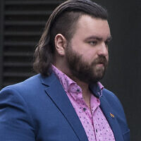 Andrew Dymock outside the Old Bailey, London, where he appeared on 15 charges relating to right-wing extremism. Dymock, 23, from Bath, is alleged to have promoted the extreme-right System Resistance Network (SRN) group through his Twitter account and website. Picture date: Thursday May 6, 2021.