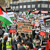 Demonstrators walk through Kensington as they make their way to the Israeli embassy in London, during a march in solidarity with the people of Palestine amid the ongoing conflict with Israel. Picture date: Saturday May 15, 2021.