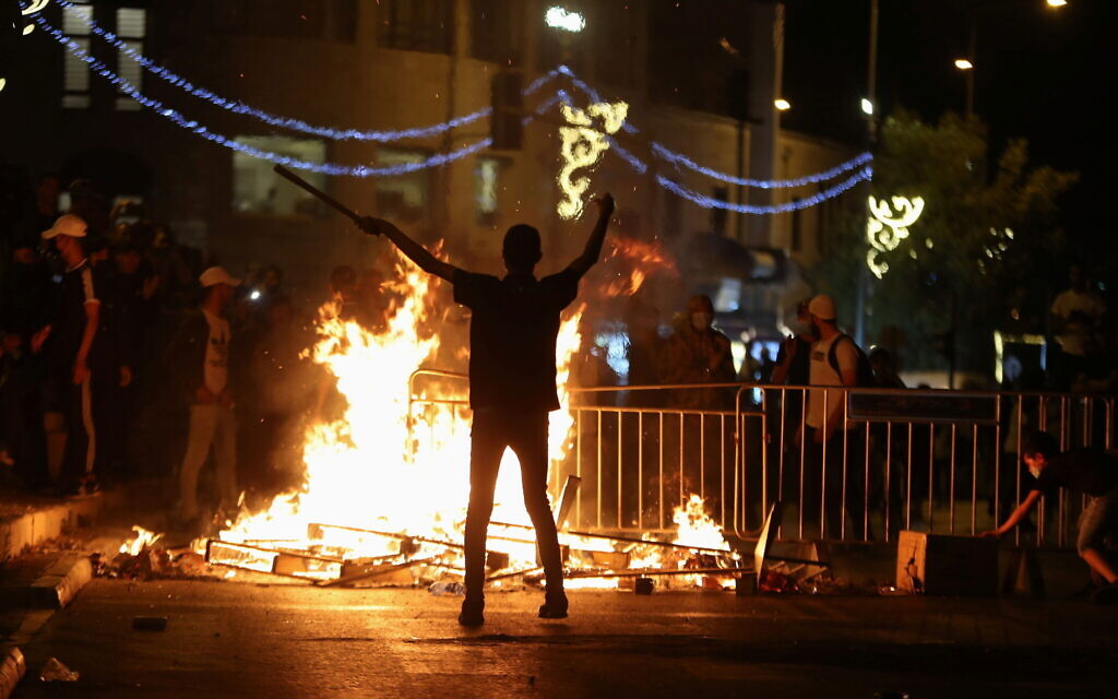 A Palestinian protester during clashes with Israeli police at Damascus Gate on Saturday night (Photo: Reuters/Ronen Zvulun)