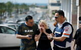 A woman at the scene where a rocket launched from the Gaza Strip hit Ashkelon on Tuesday (Photo: Reuters/Amir Cohen)