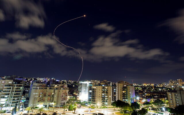 A streak of light is seen over Ashkelon as Israel's Iron Dome anti-missile system intercepts rockets launched from the Gaza Strip earlier this week (Photo: Reuters/Amir Cohen)