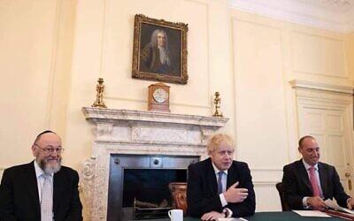 Prime Minister Boris Johnson with Chief Rabbi Ephraim Mirvis and the Downing Street Chief of Staff, Dan Rosenfield.
