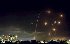 A long exposure picture shows iron dome anti-missile system fires interception missiles as rockets fired from the Gaza Strip to Israel, as it seen from the southern Israeli city of Ashkelon, May 10, 2021. Photo by Edi Israel/Flash90