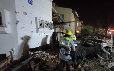 Emergency service workers look through the rubble of a house struck by a Hamas rocket.   Images: Credit ZAKA