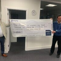 Kisharon Chairman Philip Goldberg and Kisharon Chief Executive Richard Franklin holding the Charity Extra cheque