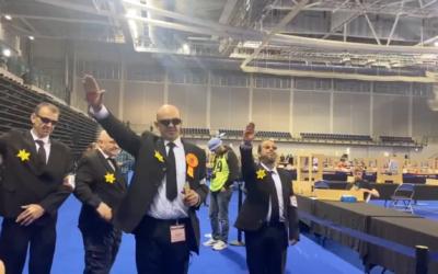 Screenshot from Twitter of Nazi-saluting yellow star-wearing Derek Jackson at a count
