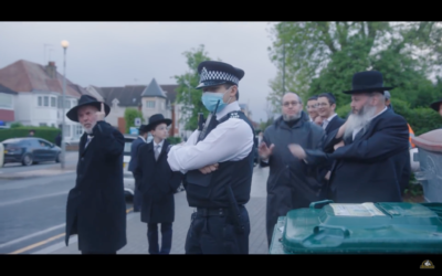 Met officers look on as an elderly Jewish man confronts the two Youtubers
