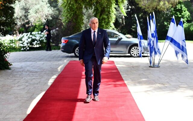 Yair Lapid arrives at the Israeli president's residence on Wednesday morning for talks on government formation (Photo: Beit HaNasi)