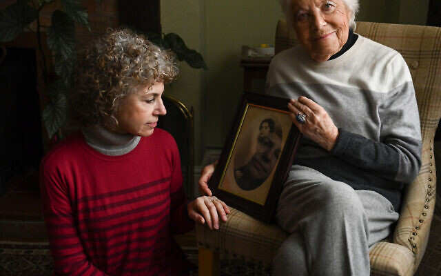 Rosl Schatzberger, aged 96, with her daughter Lesley. Rosl is holding a portrait of her mother- in-law Ida Schatzberger (nee Lewinter) who was killed in Auschwitz. (© Carolyn Mendelsohn. )