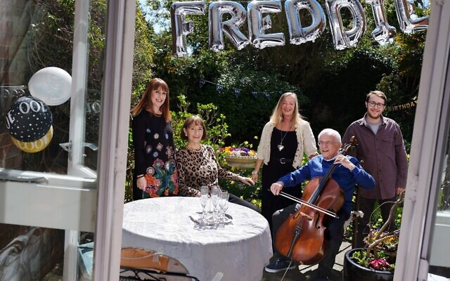 Freddie Knoller BEM photographed on his 100th birthday with his wife Freida, daughters Susie and Marcia, and grandson Nadav. (© Frederic Aranda.)