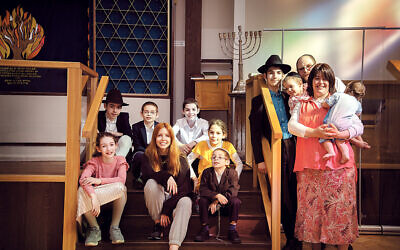 Stacey Dooley pictured with Rabbi Mordechai and his wife Blima, and their nine children, for her new series, Stacey Dooley Sleeps Over