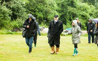 Naomi showing the Chief Rabbi around the farm.  Photograper - Rob Taylor
