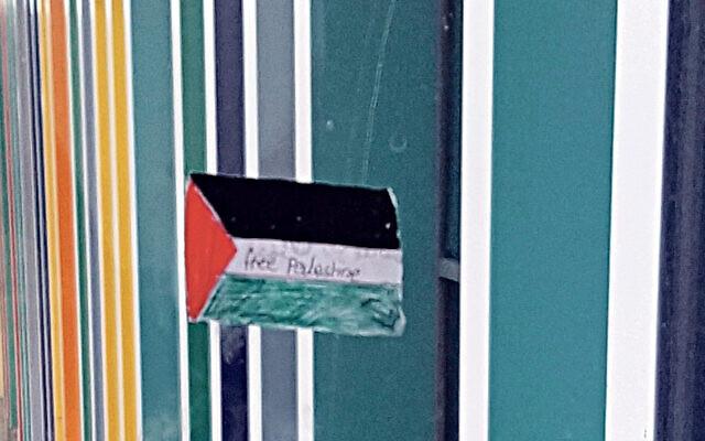 Palestine flag on a window