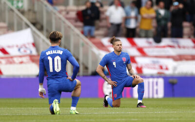 England's Jack Grealish and Kalvin Phillips take a knee before the international friendly match at Riverside Stadium, Middlesbrough. Picture date: Sunday June 6, 2021.
