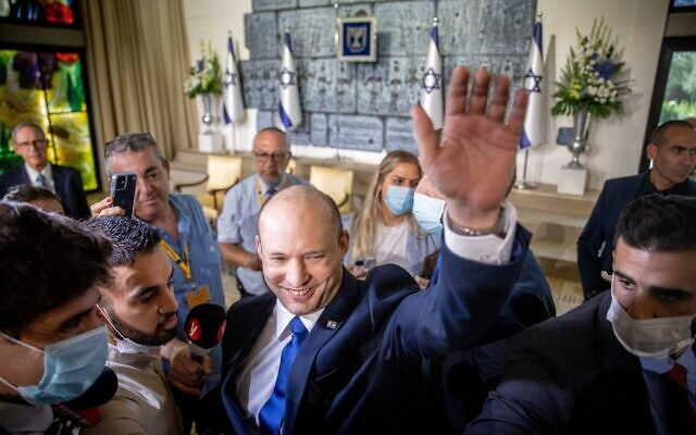 The new Israeli Prime Minister Naftali Bennett waves during a joint photo with the new government ministers at the President's residence in Jerusalem, Israel, 14 June 2021. The Knesset members on 13 June 2021 voted for the eight-party alliance led by Bennett from the far-right Jamina and Jair Lapid from the Future Party, the Knesset vote ends the historic 12-year rule of Prime Minister Benjamin Netanyahu. Photo by: JINIPIX