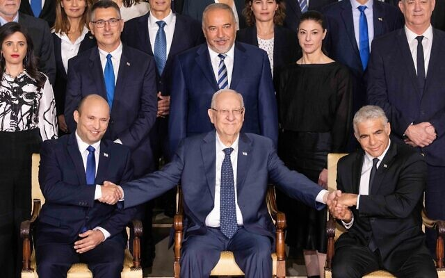 The new Israeli Prime Minister Naftali Bennett (L), Israeli President Reuven Rivlin (C) , and Alternate Prime Minister and Minister of Foreign Affairs Yair Lapid (R), during a joint photo with the new government ministers at the President's residence in Jerusalem, Israel, 14 June 2021. The Knesset members on 13 June 2021 voted for the eight-party alliance led by Bennett from the far-right Jamina and Jair Lapid from the Future Party, the Knesset vote ends the historic 12-year rule of Prime Minister Benjamin Netanyahu. Photo by: JINIPIX