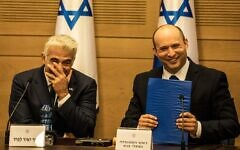 2G32HK2 13 June 2021, Israel, Jerusalem: New Israeli Prime Ministers Naftali Bennett (R), leader of the Yamina right-wing alliance, and Yair Lapid, leader of the Yesh Atid opposition centrist party attend first cabinet meeting at the Israeli Parliament (Knesset). Israeli lawmakers narrowly approved a new coalition government, putting an end to Benjamin Netanyahu's 12-year run as prime minister. Bennett, 49, will now become Israel's next Prime Minister, and is suppose to give way his post to Yair Lapid in two years' time under a rotating plan for the premiership. Photo: Ilia Yefimovich/dpa