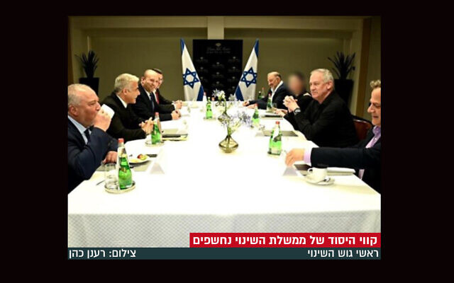 A Charedi Orthodox news site in Israel blurred the face of the only woman in a photo published on June 7, 2021. (Screenshot from Bechadrei CCharedim)