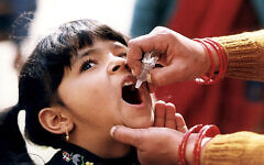 """""""Girl receiving oral polio vaccine"""" by CDC Global Health is licensed under CC BY 2.0"""