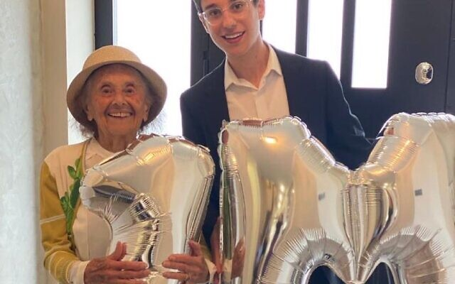 Lly and Dov celebrate with balloons after reaching 1m followers on their TikTok account (Image: Dov Forman)