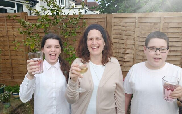 Fiona Palmer with two of her children raising a glass to pay tribute to veterans, say thank you to HM Armed Forces and honour British Jewish servicemen and women